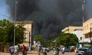 People watch as black smoke rises during twin jihadist attacks targeting the French embassy and Burkina Faso's military headquarters.  By Ahmed OUOBA (AFP/File)