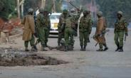 Police beat a man in Majengo, one of many towns in western Kenya where opposition protests spilled onto the streets.  By Cyril VILLEMAIN (AFP)