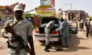 Police officers check cars at the entrance to the Pan-African Film and Television Festival (FESPACO) in Ouagadougou on February 27, 2017.  By ISSOUF SANOGO (AFP)