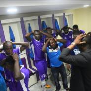 Players and officials of Mountain of Fire and Miracles Ministries football club pray in the changing room before a game at Agege Stadium.  By PIUS UTOMI EKPEI (AFP)
