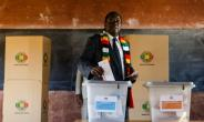 President Emmerson Mnangagwa, seen here casting his ballots, had sought to present the July 30 election as marking a new chapter for Zimbabwe.  By Jekesai NJIKIZANA (AFP/File)