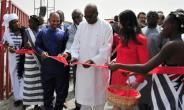 President of Burkina Faso Roch Marc Christian Kabore (C) cuts the ribbon during the inauguration of a new movie theatre which runs on solar power in Ouagadougou on February 24, 2017.  By Ahmed OUOBA (AFP)
