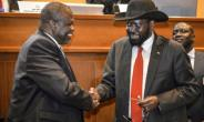 President Salva Kiir (R) and his estranged deputy  Riek Machar shake hands as they sign another peace deal.  By - (AFP/File)