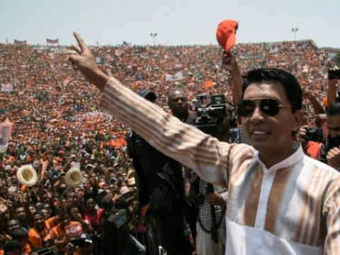 Presidential candidate and former President of the High Transitional Authority of Madagascar Andry Rajoelina waves to supporters as he arrives on stage during a campaign rally at the Colyseum stadium in Antananarivo, on November 3, 2018.  By RIJASOLO (AFP/File)