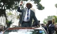 Raila Odinga waves at supporters after the landmark Supreme Court ruling scrapping last month's presidential election.  By SIMON MAINA (AFP/File)