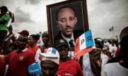 Rwandan President Paul Kagame is widely expected to win a third term in office in a race against little-known candidates.  By MARCO LONGARI (AFP)
