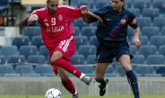 Saadi Kadhafi, son of former Libyan dictator Moamar Kadhafi, plays for Tripoli's Al-Ittihad club against FC Barcelona in an April 2, 2003 match at Camp Nou in Spain.  By LLUIS GENE (AFP/File)