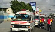 Somali ambulances carrying severely injured patients from a 2017 bomb blast in Mogadishu wait for access to the airport, where military planes are set to fly the wounded to Turkey for treatment.  By MOHAMED ABDIWAHAB (AFP)