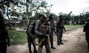 Soldiers from the Armed Forces of the Democratic republic of the Congo (FARDC) are seen gearing up as gunfire erupts close by on October 7, 2018 outside Oicha.  By JOHN WESSELS (AFP/File)