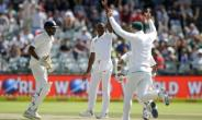 South African bowler Kagiso Rabada (centre) celebrates the dismissal of Indian batsman Wriddhiman Saha during their fourth day of the first Test match in Cape Town, on January 8, 2018.  By GIANLUIGI GUERCIA (AFP)