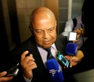 South African finance minister Pravin Gordhan speaks with journalists outside of the High Court on March 28, 2017 in Pretoria.  By Phil MAGAKOE (AFP)
