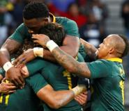 Springboks winger Courtnall Skosan (L/11#) is mobbed by teammates as he celebrates scoring a try during the International Rugby Test match against Argentina August 19, 2017.  By MICHAEL SHEEHAN (AFP)