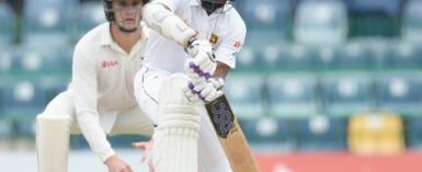 Sri Lankan batsman Niroshan Dickwella plays a shot during the final day of a one-off Test match between Sri Lanka and Zimbabwe at the R Premadasa Stadium in Colombo on July 18, 2017.  By ISHARA S. KODIKARA (AFP)