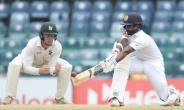 Sri Lanka's Niroshan Dickwella plays a shot as Zimbabwe's Peter Moor looks on during the final day of their one-off Test match at the R Premadasa Cricket Stadium in Colombo on July 18, 2017.  By ISHARA S. KODIKARA (AFP)
