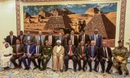Sudan's President Omar al-Bashir (6th-L, front) poses for a group photo with members of his new 20-member cabinet as they take the oath of office at the presidential palace in Khartoum.  By ASHRAF SHAZLY (AFP)