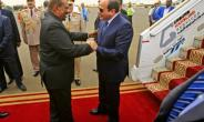 Sudan's President Omar al-Bashir (C-L) embraces his Egyptian counterpart Abdel-Fattah al-Sisi (C-R) upon the latter's arrival at Khartoum International Airport  on October 25, 2018.  By ASHRAF SHAZLY (AFP)