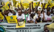 Supporters of opposition candidate Jean Ping gather at a rally in Libreville on the last day of the presidential election campaign.  By Marco Longari (AFP)
