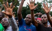 Supporters of Zimbabwe opposition leader Morgan Tsvangirai take part in a Harare rally by the main opposition parties calling for free and fair elections next year.  By Jekesai NJIKIZANA (AFP)