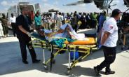 Survivors of Somalia's worst-ever bombing were taken to Turkey for treatment.  By MOHAMED ABDIWAHAB (AFP)