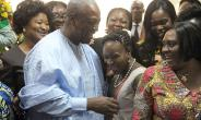 President John Dramani Mahama swarmed by some female MPs in Parliament yesterday