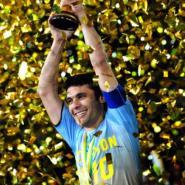 Egyptian captain, Ahmed Hassan, holding aloft the trophy