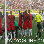 Sudan players attending to their injured goal keeper in the match against Ghana