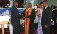 REVEREND FRENCH RECEIVING A CITATION IN HONOUR OF HIS SERVICE.