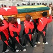 Togo players carrying their colleague