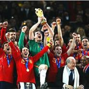 Casillas and his team mates lift aloft the World Cup in wild jubilation