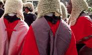 High Court Judge dragged to court