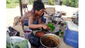 A woman prepares food on April 8, 2014 at a