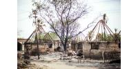 A picture shows burned down houses in the backyard of Malakal Teaching Hospital on March 4, 2014, in Malakal, South Sudan.  By Andrei Pungovschi (AFP)