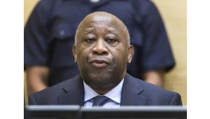 Former Ivorian President Laurent Gbagbo attends a pre-trial hearing on charges of crimes against humanity at the International Criminal Court in The Hague, on February 19, 2013.  By Michael Kooren (Pool/AFP/File)