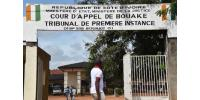 A man walks past the courthouse in Bouake on October 22, 2014 during the trial of a man found guilty of giving his 11-year-old daughter in marriage.  By Issouf Sanogo (AFP/File)
