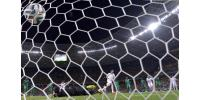 Ivory Coast's goalkeeper Boubacar Barry concedes a penalty to Greece's forward Georgios Samaras (back C) at the Castelao Stadium in Fortaleza during the 2014 FIFA World Cup on June 24, 2014.  By Aris Messinis (AFP)